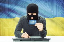 41627738 - cybercrime concept with flag on background - ukraine