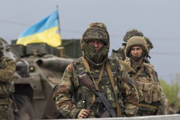 "A Ukrainian soldier stands guard near an armoured personnel carrier at a checkpoint near the town of Slaviansk in eastern Ukraine May 2, 2014. Pro-Russian rebels shot down two Ukrainian helicopters on Friday, killing two crew, as troops tightened their siege of separatist-held Slaviansk and Moscow accused Kiev of launching a ""criminal"" assault that wrecked hopes of peace.  REUTERS/Baz Ratner (UKRAINE - Tags: POLITICS CIVIL UNREST MILITARY)"