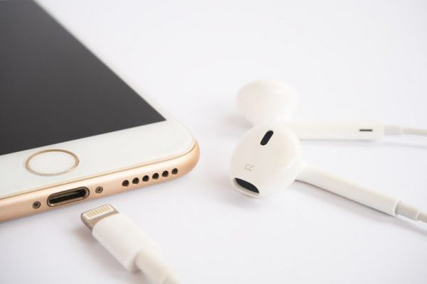 62874352 - chiangrai, thailand -september 9, 2016: close-up image of new apple iphone7 mockup and new apple earpods mockup on white background.