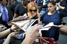 18979068 - new york - april 9: lindsay lohan greets fans after her david letterman appearance outside the ed sullivan theater on april 9, 2013 in manhattan.