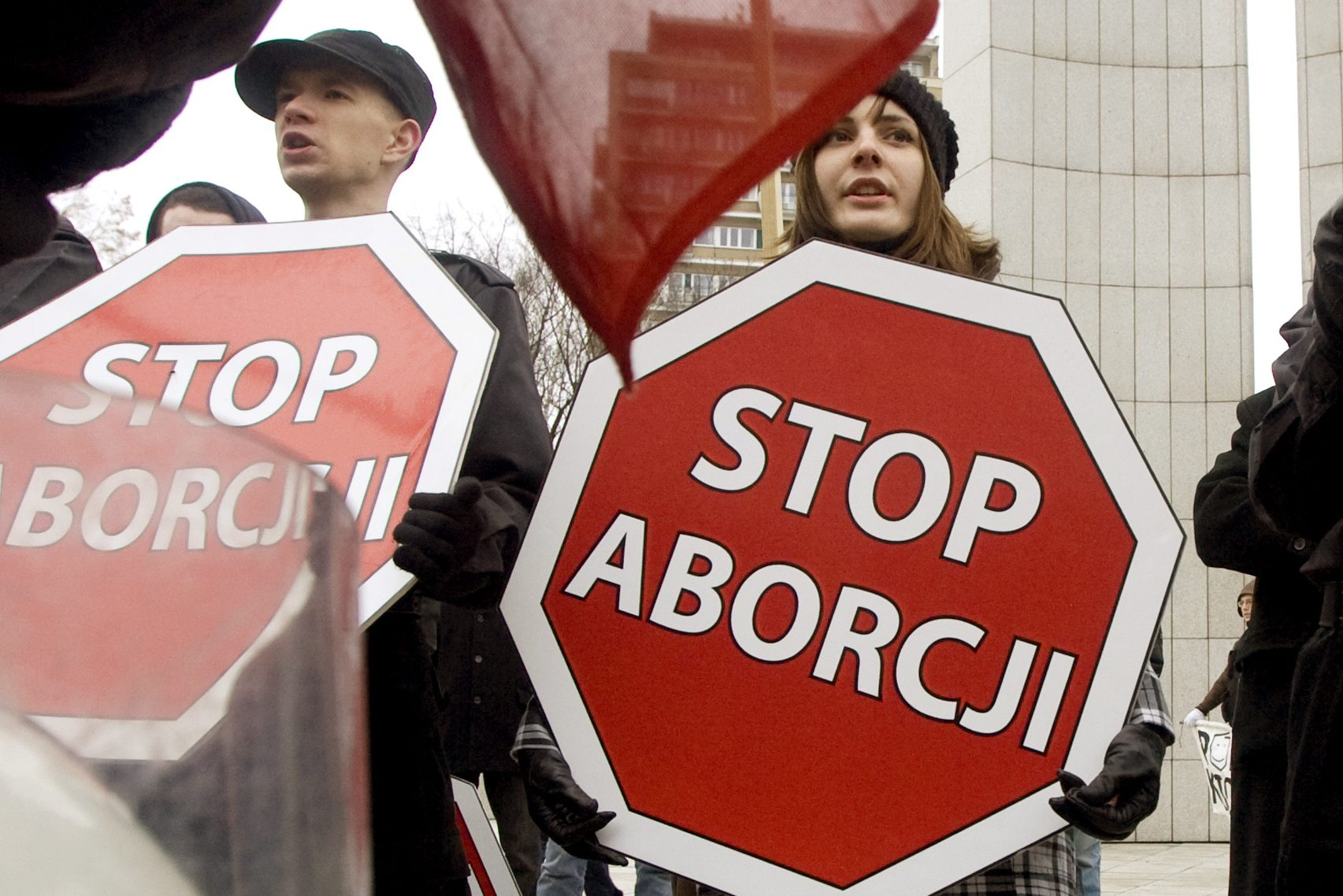 """People hold placards as they take part in a rally in central Warsaw, March 8, 2009. Several thousand people gathered in Poland capital to mark International Women's Day on Sunday. The placards read, """" Stop abortion"""".  REUTERS/Vasily Fedosenko  (POLAND POLITICS SOCIETY CONFLICT) - RTXCI8F"""