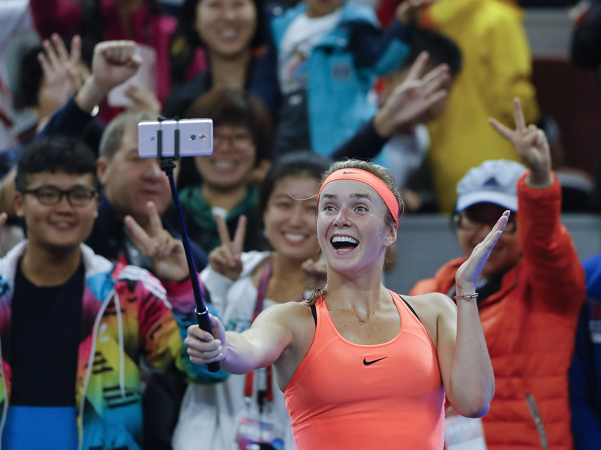 BEIJING, CHINA - OCTOBER 06:  Elina Svitolina of Ukraine takes a selfie after winning the Women's singles third round match against Angelique Kerber of Germany on day six of the 2016 China Open at the China National Tennis Centre on October 6, 2016 in Beijing, China.  (Photo by Lintao Zhang/Getty Images)