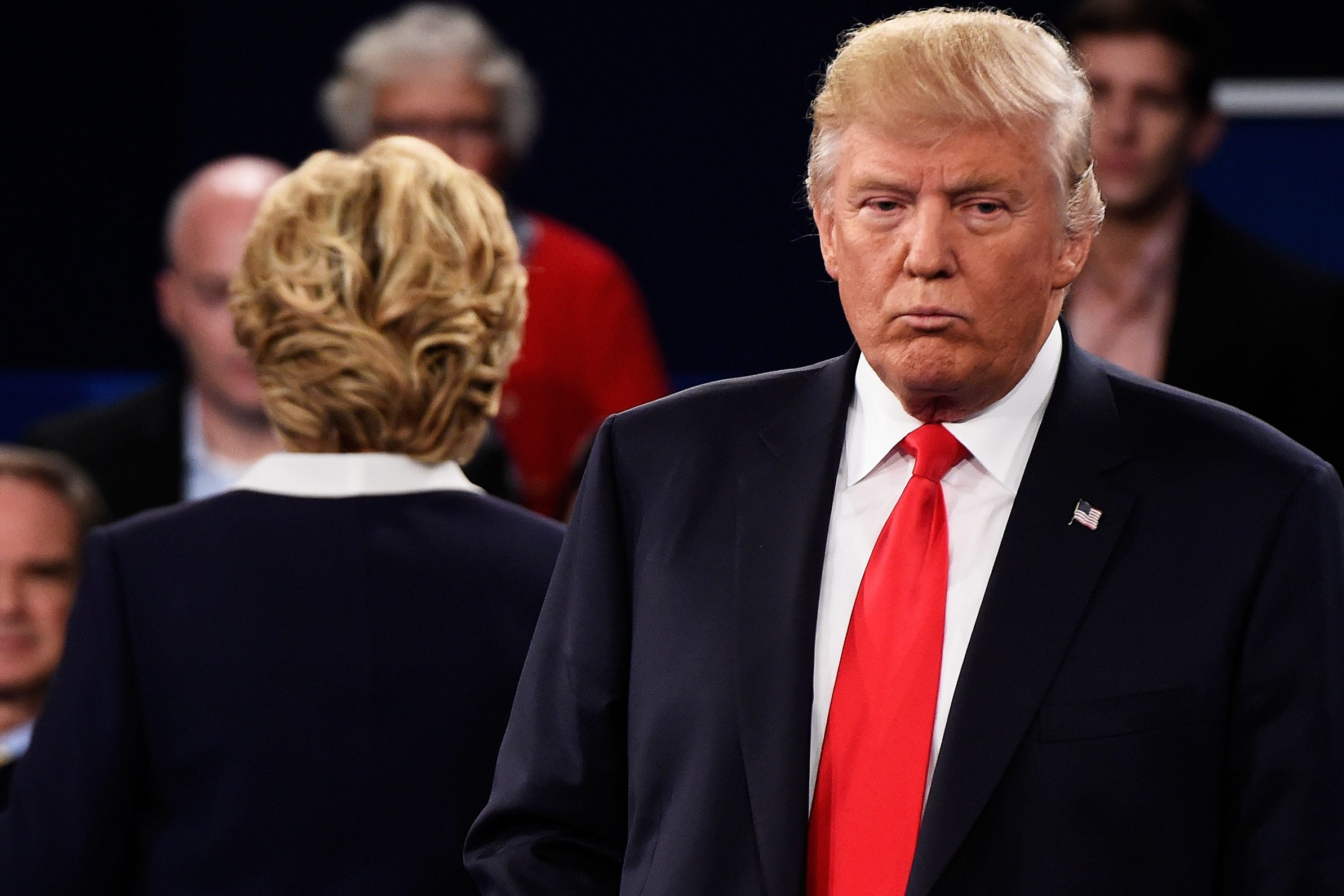 ST LOUIS, MO - OCTOBER 09:  Democratic presidential nominee former Secretary of State Hillary Clinton (L) and Republican presidential nominee Donald Trump listen to a question during the town hall debate at Washington University on October 9, 2016 in St Louis, Missouri. This is the second of three presidential debates scheduled prior to the November 8th election.  (Photo by Saul Loeb-Pool/Getty Images)