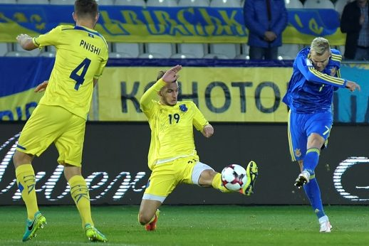 KRAKOW, POLAND - OCTOBER 09 :Andriy Yarmolenko (7) of Ukraine in action against Alban Pnishi (4) of Kosovo during the UEFA 2018 World Cup Qualifying match between Ukraine and Kosovo at Marshal Józef Pisudski Stadium in Krakow, Poland on October 09, 2016.  (Photo by OMAR MARQUES/Anadolu Agency/Getty Images)
