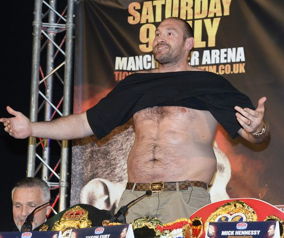 epa05279803 British WBA, WBO, IBO, and IBF heavyweight boxing world champion Tyson Fury speaks during a press conference in Manchester, Britain, 27 April 2016. Fury will defend his World Heavyweight title against Ukrainian challenger Wladimir Klitschko at Manchester Arena on 09 July 2016.  EPA/PHIL RICHARDS