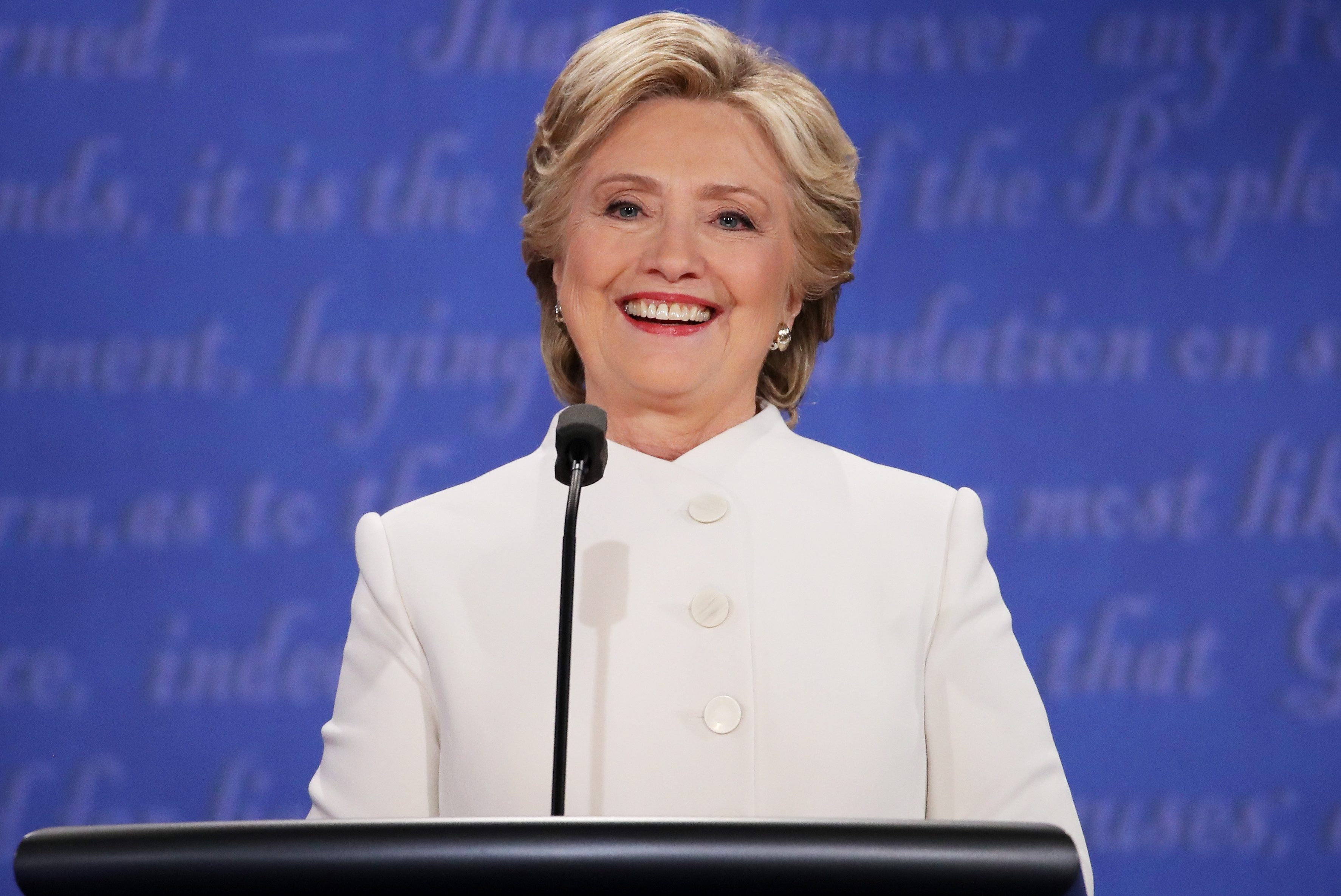 LAS VEGAS, NV - OCTOBER 19:  Democratic presidential nominee former Secretary of State Hillary Clinton smilels as she listens to Republican presidential nominee Donald Trump speak during the third U.S. presidential debate at the Thomas & Mack Center on October 19, 2016 in Las Vegas, Nevada. Tonight is the final debate ahead of Election Day on November 8.  (Photo by Drew Angerer/Getty Images)