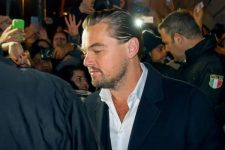 50812907 - rome, italy - 15 january 2016: in the image leonardo dicaprio in the vicinity of the house of cinema in rome. the actor is shown here surrounded by fans and security men. we are in a public place, in the street, before it enters the red carpenter.