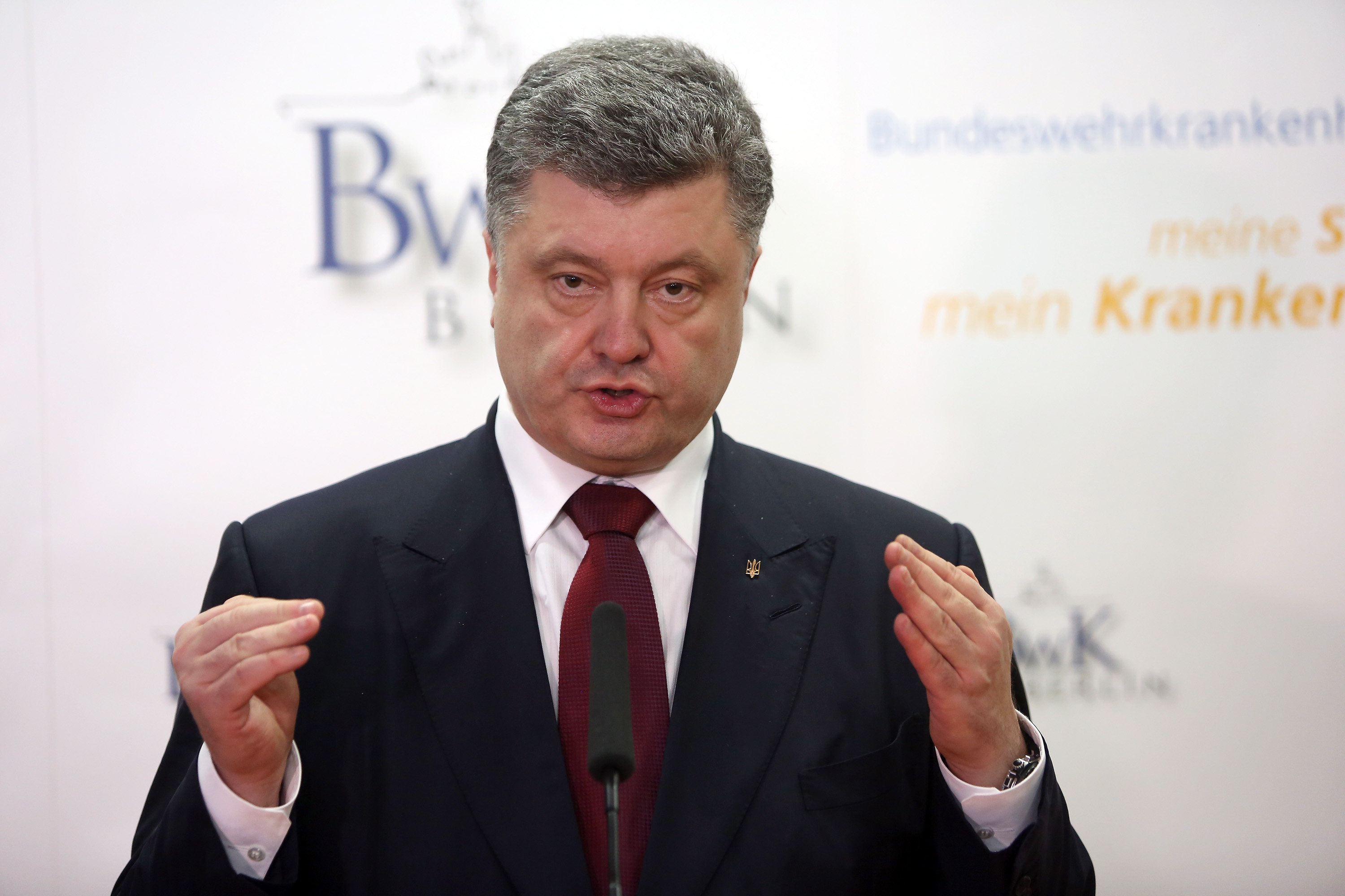 BERLIN, GERMANY - MARCH 16:  Ukrainian President Petro Poroshenko gives a statement to the press at the Bundeswehrkrankenhaus, a hospital in which German military, German government employees and ordinary civilians are treated, on March 16, 2015 in Berlin, Germany. Poroshenko was in Berlin for a meeting with German Chancellor Angela Merkel over the implementation of the Minsk ceasefire agreement as well as further reforms to help stabilize the troubled country. The conflict between Russian-backed separatists and government troops that began in Ukraine last year has claimed over 6,000 lives and displaced nearly 1.8 million people, according to the human rights office of the United Nations. The German military has been active in assisting those injured in the ongoing dispute in the region, treating the country's own soldiers sent to Germany for medical aid, and has provided non-lethal military equipment such as protective vests. Poroshenko is expected to request more such assistance during his visit to the country.  (Photo by Adam Berry/Getty Images)