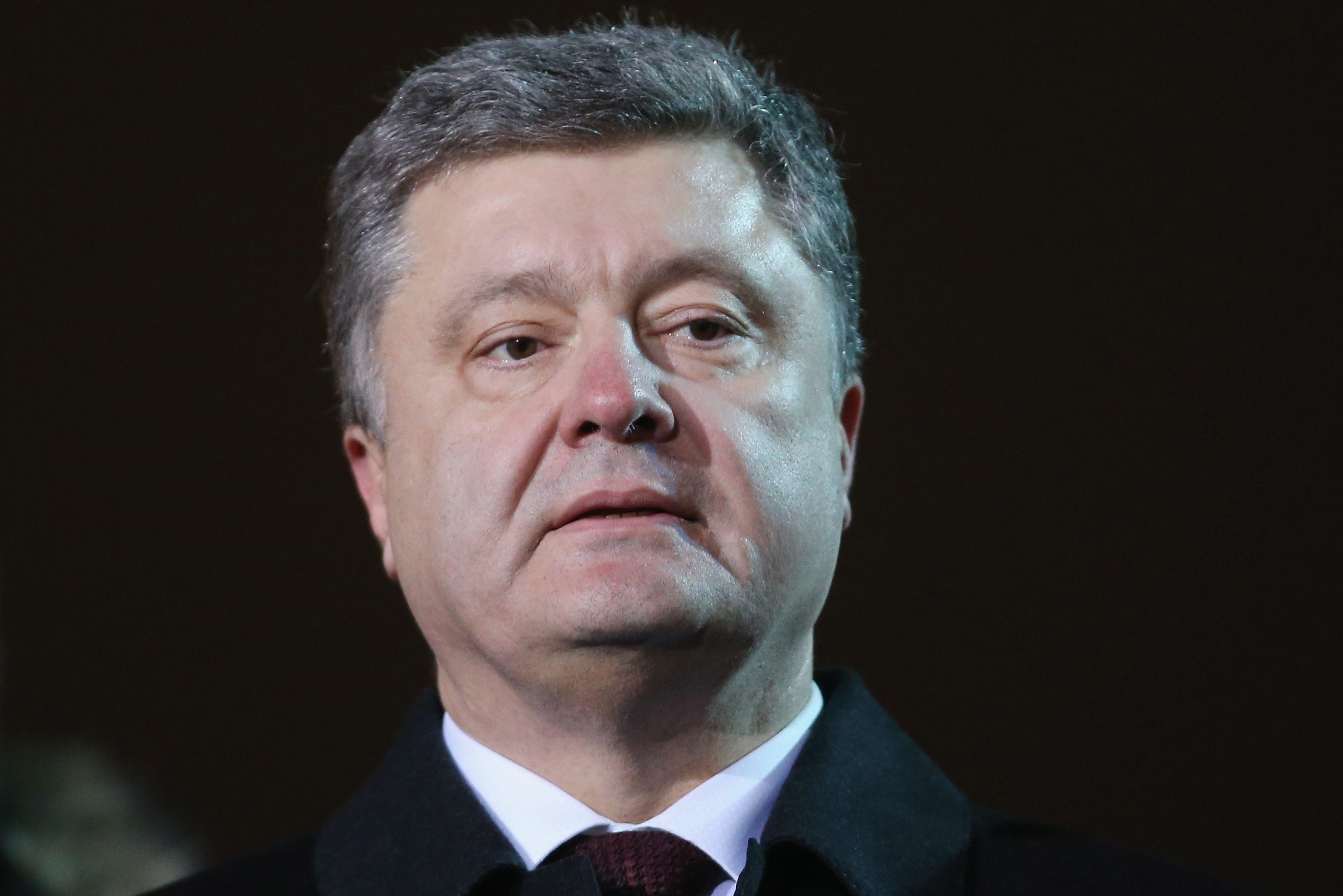 KIEV, UKRAINE - FEBRUARY 20:  Ukrainian President Petro Poroshenko attends an evening ceremony to commemorate victims of the Maidan uprising one year ago at Maidan square on February 20, 2015 in Kiev, Ukraine. Ukraine is commemorating the first anniversary of the February 20, 2014 sniper attacks that killed dozens of protesters on the Maidan and were followed by the ouster of Ukrainian President Viktor Yanukovich shortly later. Meanwhile fighting between pro-Ukrainian troops and pro-Russian separatists is continuing in the Donbas region of eastern Ukraine despite the recent Minsk ceasefire agreements.  (Photo by Sean Gallup/Getty Images)