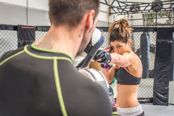 38769694 - mma training with focus mitt