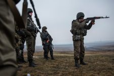 MARIUPOL, UKRAINE - MARCH 13:  Ukrainian troops from Donbass battalion train with small arms on March 13, 2015 outside Mariupol, Ukraine. The Minsk ll ceasefire agreement, which has continued to hold despite being violated more than 1,000 times, is nearing the one month mark.  (Photo by Andrew Burton/Getty Images)