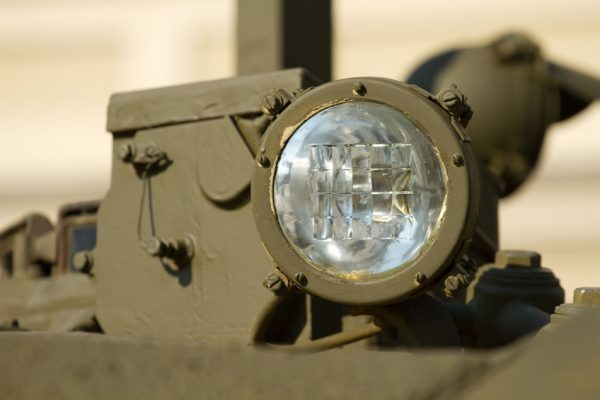 48450336 - headlight close-up on a military tank