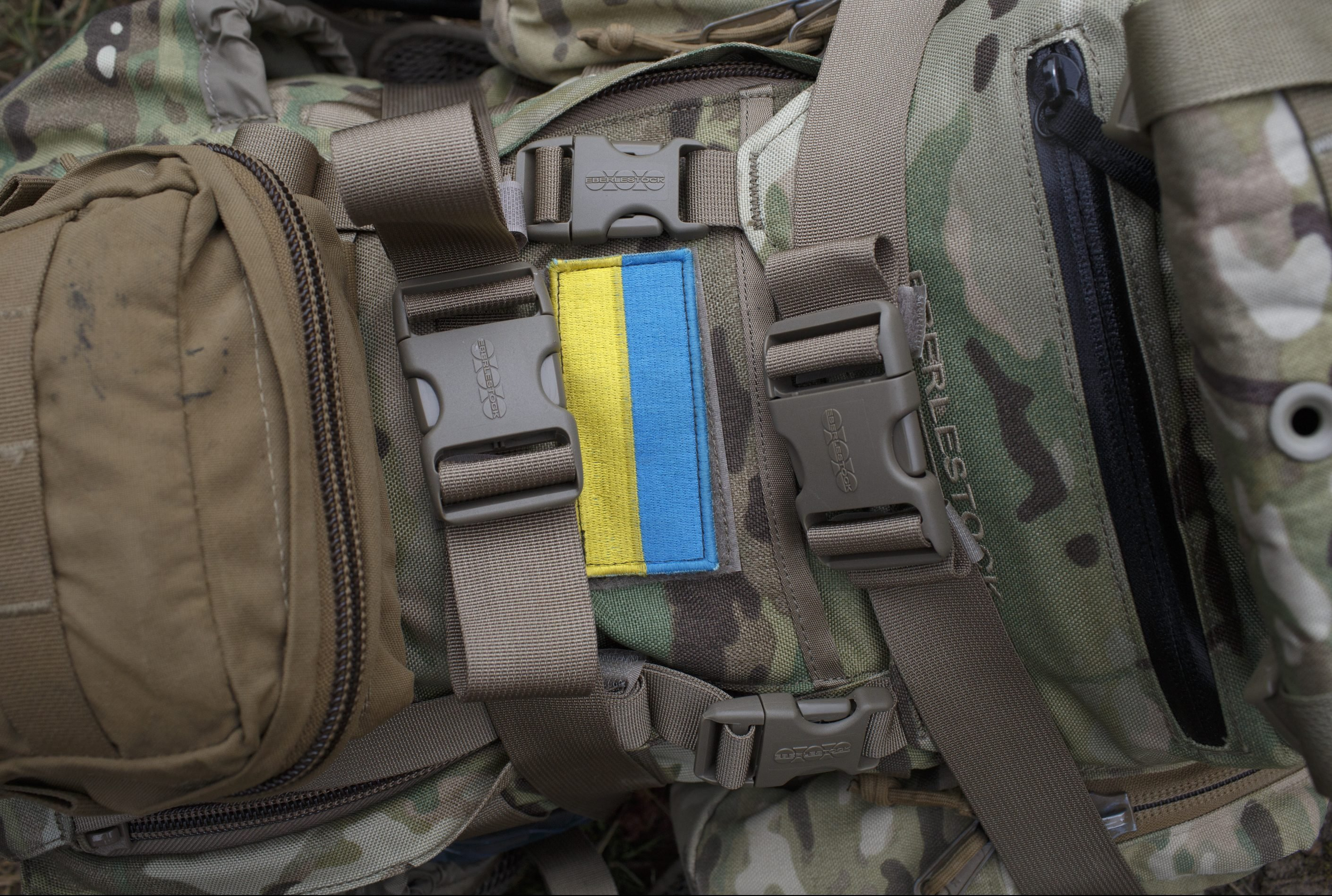 YAVORIV, UKRAINE - APRIL 21: A Ukrainian flag is seen on the backpack of an American Soldier during Operation Fearless Guardian on April 21, 2015 at the International Peacekeeping and Security Center near Yavoriv, Ukraine. The American soldier said he received the flag as a gift from one of the Ukrainian soldiers he is training. Operation Fearless Guardian is a six-month training exercise involving about 300 members of the American 173rd Airborne and about 900 Ukrainian National Guard troops. (Photo by Pete Kiehart/Getty Images)