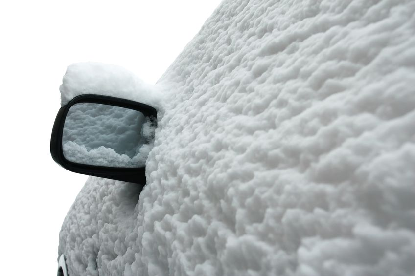 17858281 - side view of a car in winter after snow storm isolated on white background the whole car is covered with snow