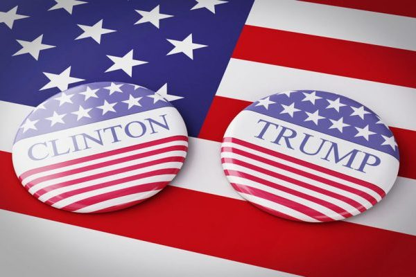 56857977 - buenos aires, argentina - 12 may, 2016: 3d illustration of presidential campaign pins of hillary clinton and donald trump running for the president's office with us flag.