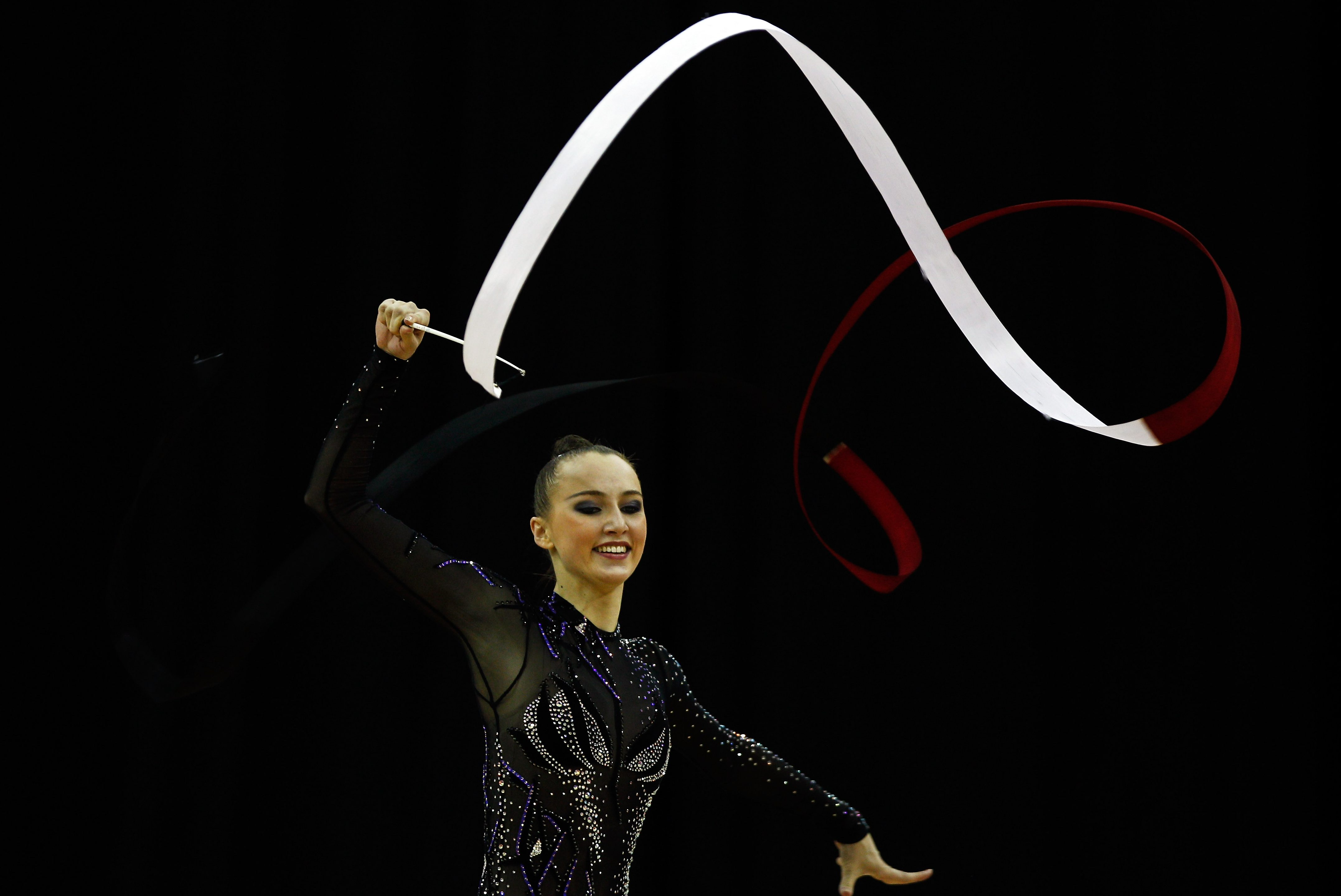 LONDON, ENGLAND - JANUARY 18:  Ganna Rizatdinova of Ukraine in action in the Individual All-Around during the FIG Rhythmic Gymnastics Olympic Qualification round at North Greenwich Arena on January 18, 2012 in London, England.  (Photo by Paul Gilham/Getty Images)