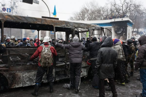 25220910 - kiev, ukraine - 21 january 2014 unknown demonstrators at the independence square during ukrainian revolution on january 21, 2014 in kiev, ukraine