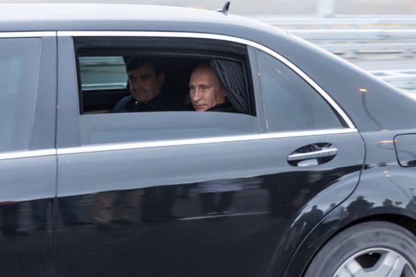 54010194 - moscow, russia - november 24, 2015: vladimir vladimirovich putin russian president in car