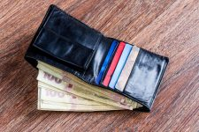 53743874 - wallet of rich men / women with one hundred hryvnia