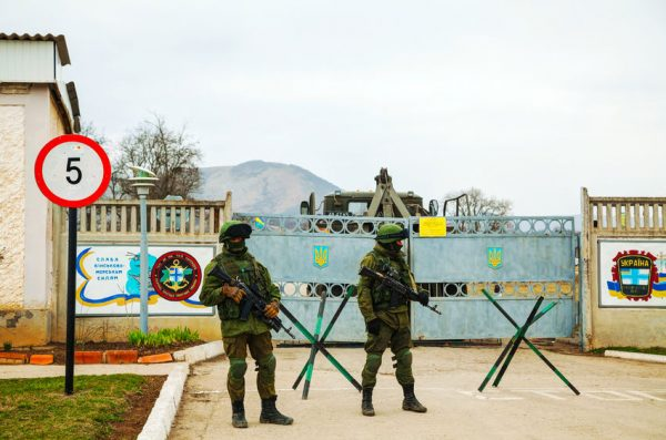 26879891 - perevalne, ukraine - march 4  russian soldiers guarding an ukrainian naval base on march 4, 2014 in perevalne, crimea, ukraine  on february 28, 2014 russian military forces invaded crimea peninsula