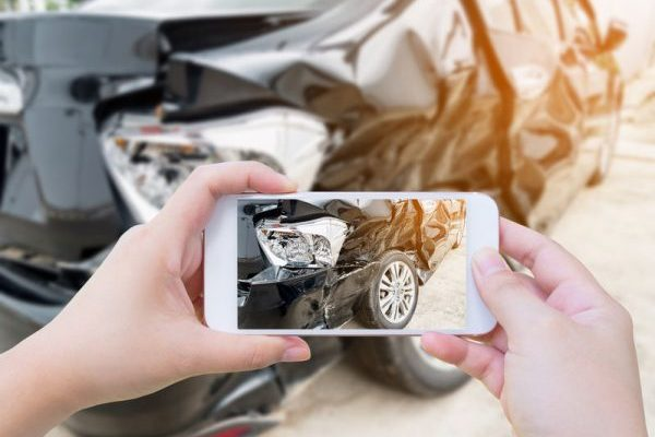 65881144 - female hold mobile smartphone photographing car accident for insurance