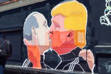 58170475 - vilnius, lithuania - may 13,2016: mural artwork of russian president vladimir putin and u.s. presidential hopeful donald trump kissing on the side of a barbecue restaurant in vilnius, lithuania.