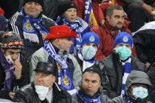 7659597 - kiev, ukraine - november 4, 2009: dynamo kiev fans weared protective masks and filled up the stadium during an uefa cl match despite fears of the spread of the a/h1n1 virus on nov 4, 2009 in kiev