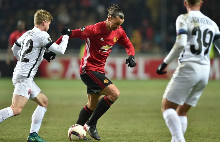 Zorya Luhansk's Serbian midfielder Zeljko Ljubenovic (L) vies for the ball with Manchester United's Swedish forward Zlatan Ibrahimovic (R) during the UEFA Europa League football match between FC Zorya Luhansk and Manchester United FC at the Chornomorets stadium in Odessa on December 8, 2016.  / AFP / SERGEI SUPINSKY        (Photo credit should read SERGEI SUPINSKY/AFP/Getty Images)