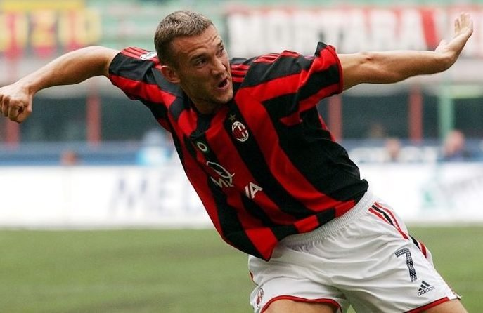 A.C. Milan forward Andriy Shevchenko of Ukraine celebrates after scoring against Lecce, during the Italian major league match soccer between AC MIlan and Lecce, at the San Siro stadium in Milan, Italy, Sunday, Sept. 28, 2003. (AP Photo/Luca Bruno)
