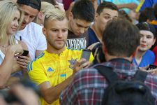 62164830 - kyiv, ukraine - august 29, 2016: player andriy yarmolenko makes selfie with fans during open training session of ukraine national football team before fifa world cup 2018 qualifying matches
