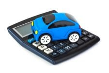 4950222 - calculator and toy car isolated on white background