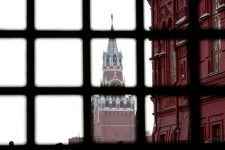 28086220 - moscow, russia - march 23, 2014: red square in moscow seen through the gate - concept of russia under sanctions