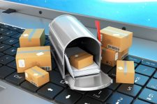 62789915 - online shopping, shopping online, the concept of delivery of goods, cardboard boxes and a mailbox with envelopes on the laptop keyboard. 3d illustration