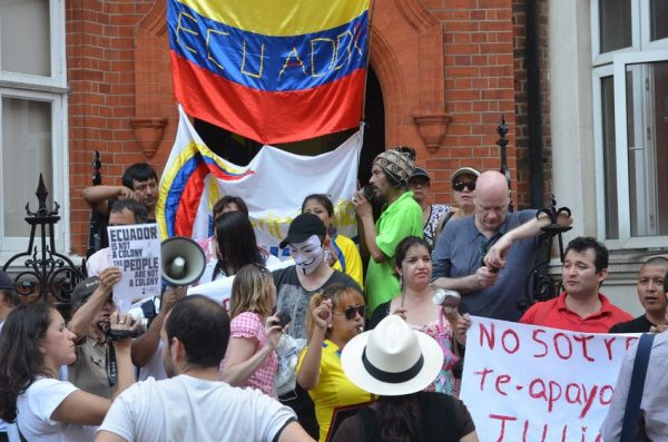 15838216 - london – august 19: protesters outside julian assange protest outside the ecuadorian embassy london august 19th, 2012 in london, england.