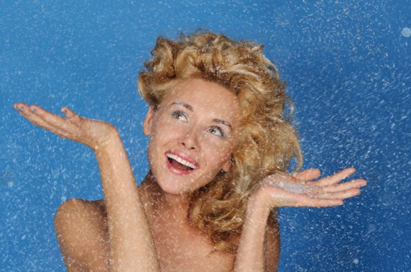 65718889 - woman with beautiful hair under snow on blue background