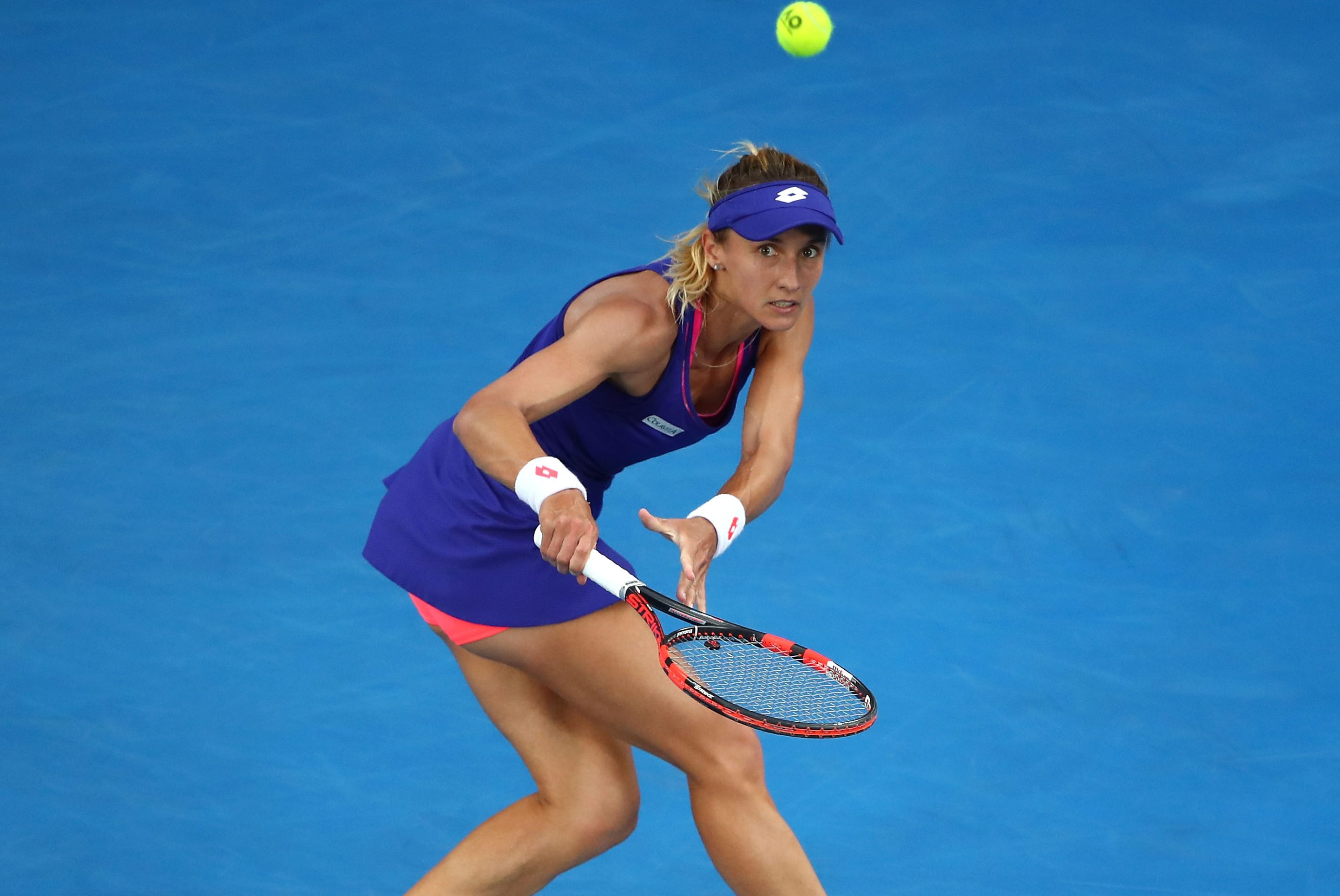 MELBOURNE, AUSTRALIA - JANUARY 16:  Lesia Tsurenko of the Ukraine plays a shot in her first round match against Angelique Kerber of Germany on day one of the 2017 Australian Open at Melbourne Park on January 16, 2017 in Melbourne, Australia.  (Photo by Clive Brunskill/Getty Images)