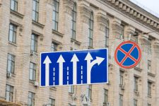8433620 - road sign hanging on the rope while building city hall in kiev, ukraine