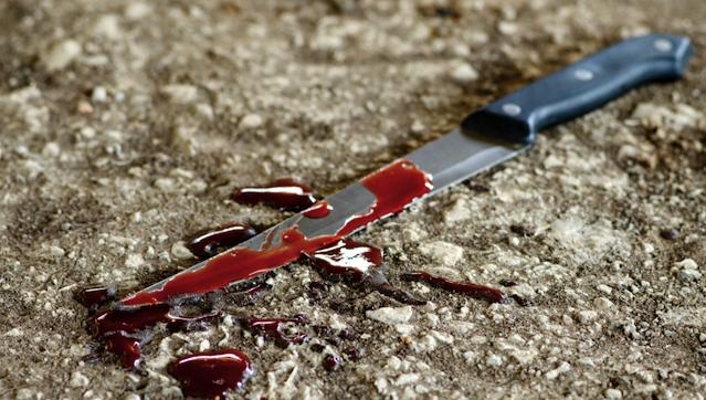 Поки за дверима перебував 8-річний син: у Києві чоловік зарізав колишню дружину